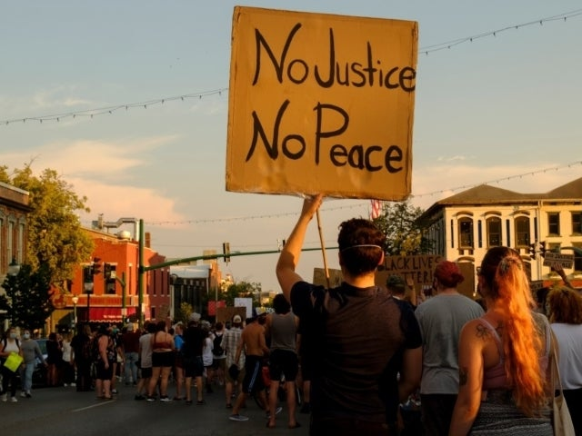 Indiana Woman Arrested After Driving Into Protesters