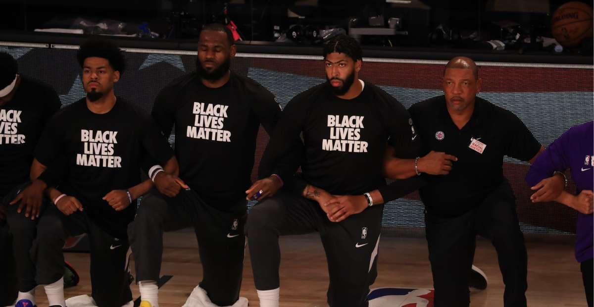 LeBron James fellow NBA players kneel national anthem