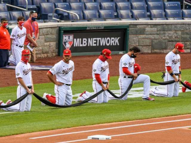 Yankees and Nationals Players Kneel Before National Anthem of MLB Opening Day Game