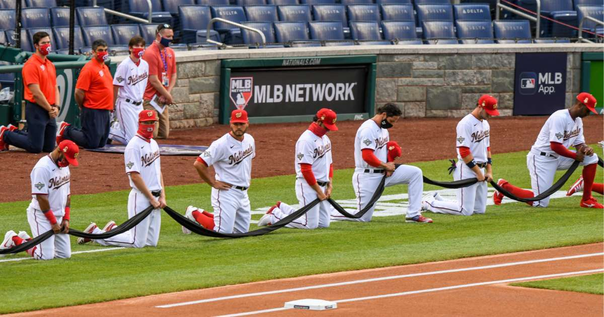 Nationals Yankees players kneel national anthem MLB Opening Day game