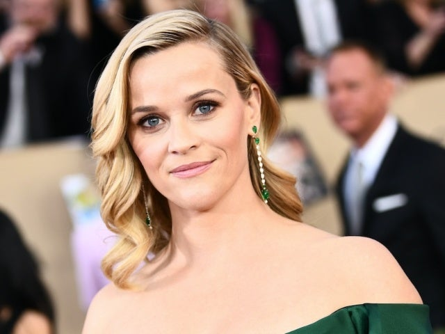 Reese Witherspoon 'Heartbroken for the Whole Travolta Family' After Kelly Preston's Death