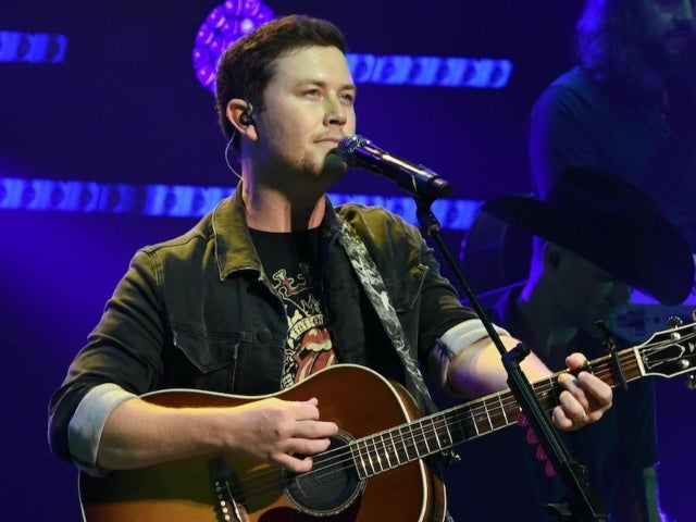 Scotty McCreery Sings 'Go Rest High on That Mountain' to Honor Late Friend