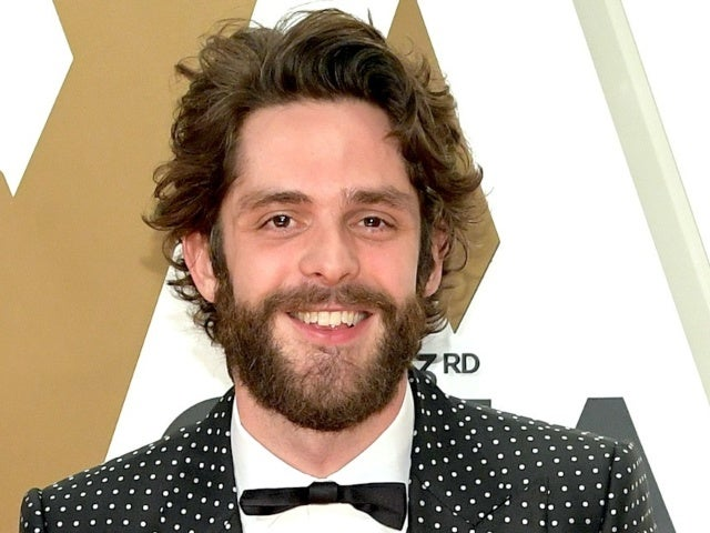 Thomas Rhett Straps Baby Lennon in a Backpack to Calm Her Down in New Photo