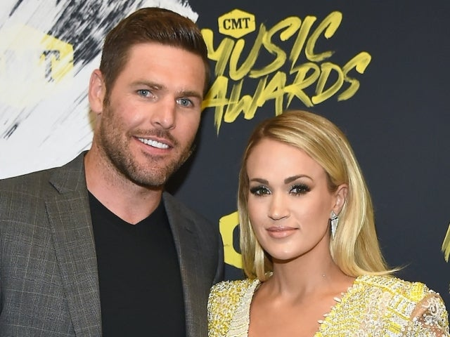 Carrie Underwood Needs a New Hat in Date Night Photo With Mike Fisher