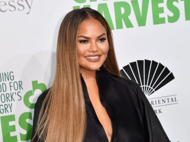Chrissy Teigen Reveals First Look at Bare Baby Bump