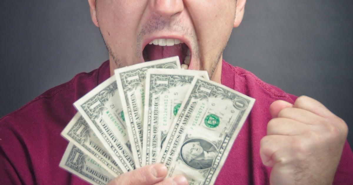 mad-money-cash-stimulus-bills-dollars-angry-getty