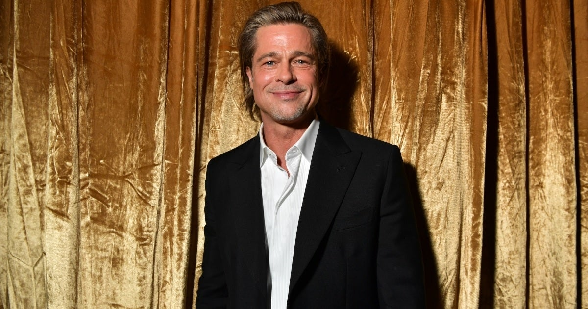brad pitt gold curtains getty images