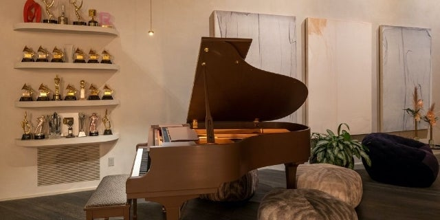 chrissy-teigen-john-legend-BH-home-piano-award-wall
