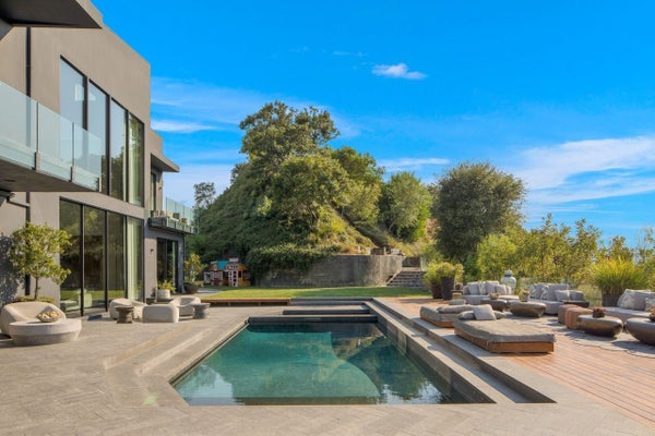 chrissy-teigen-john-legend-BH-home-pool