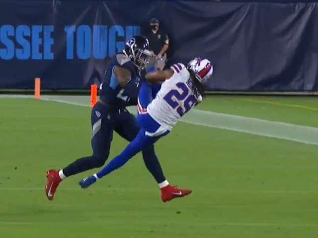 Watch Titans' Derrick Henry Deliver Monster Stiff-Arm to Bills' Josh Norman