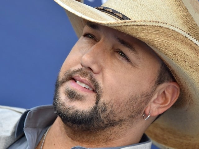 Jason Aldean Sparks Controversy After Maskless Disney World Family Photo
