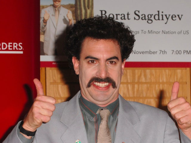Sacha Baron Cohen as Borat 'Defends' Rudy Giuliani After Controversial 'Borat 2' Leaked Scene