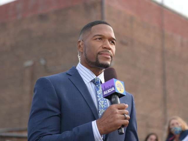Michael Strahan and His Daughter Make an Ice Cream Pit Stop While Walking Their Dog