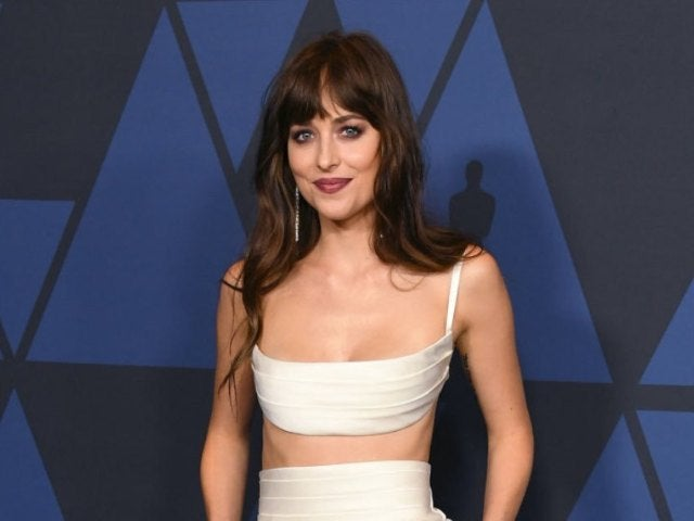 Dakota Johnson Sparks Chris Martin Engagement Rumors While Wearing Huge Ring