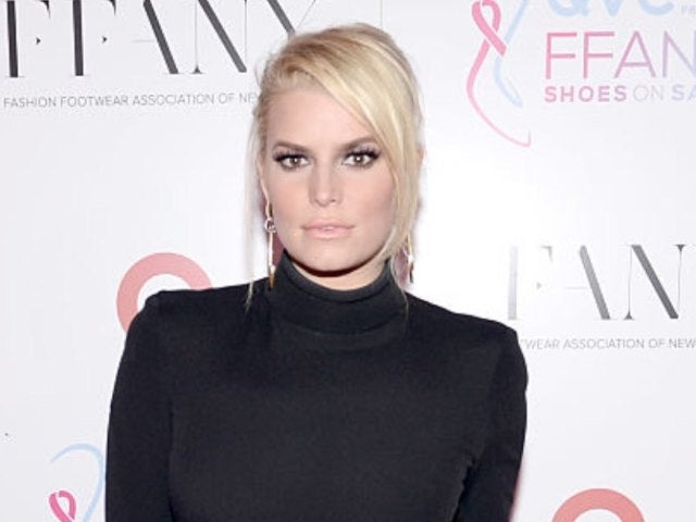 Jessica Simpson Shows off 100-Pound Weight Loss in Christmas Onesie Photo