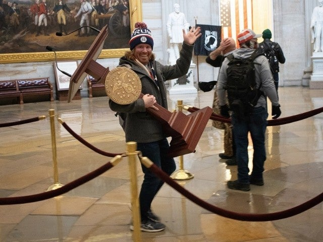 Adam Johnson, Man Pictured Carrying Nancy Pelosi's Lectern, Arrested After Capitol Riot