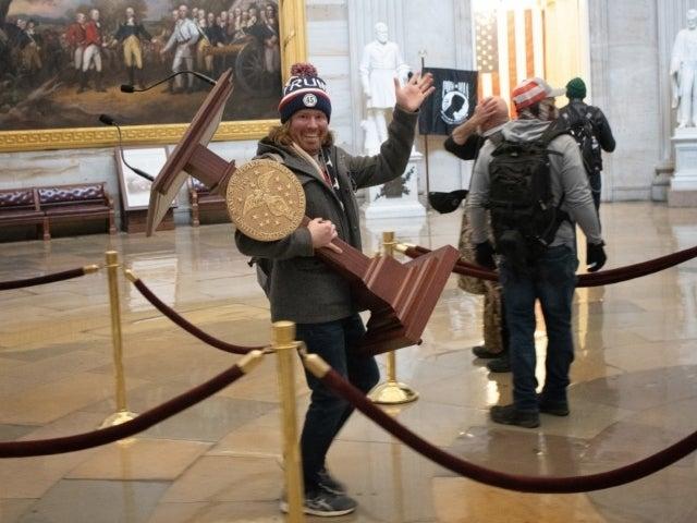 Florida Man Steals Nancy Pelosi's Podium During Capitol Riots