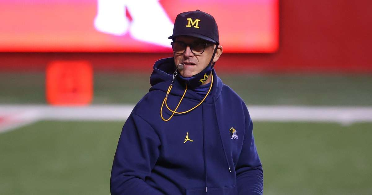 Jim Harbaugh signs contract extension 2026 fans not happy