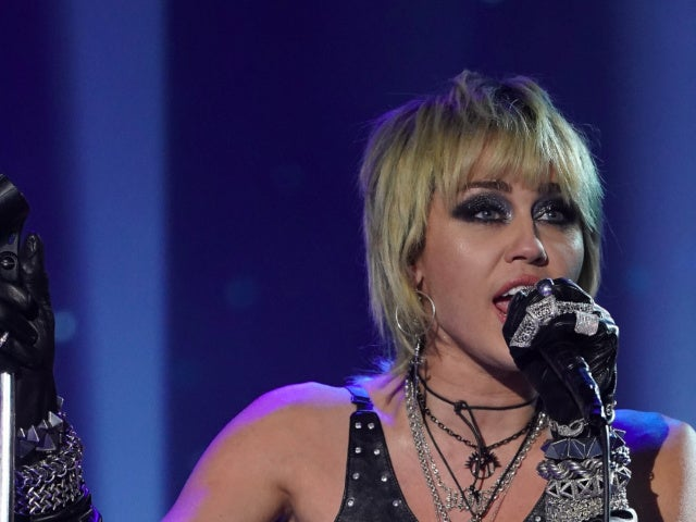 Miley Cyrus Paid Homage to Britney Spears With Super Bowl Pregame Performance