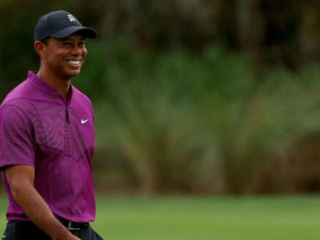 Tiger Woods Update: Golfer on Crutches, Smiling in First Photo Since Crash