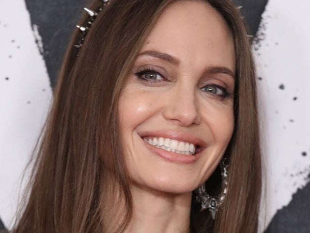 Angelina Jolie Gets Covered in Bees for Stunning Shoot on World Bee Day