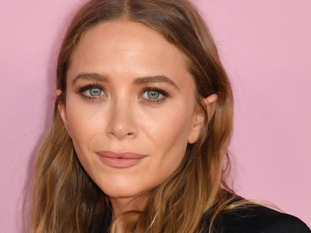 Mary-Kate Olsen Is All Smiles in Rare Public Outing