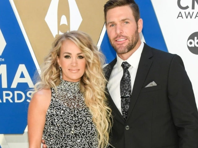 Carrie Underwood and Husband Mike Fisher Saddle up for Ranch Vacation