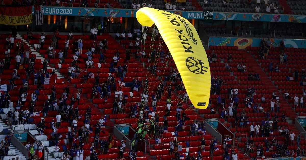Euro 2020 protester parachutes into stadium injures several fans crash landing