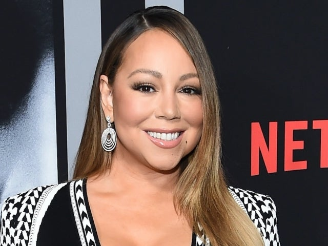 Mariah Carey Transforms Herself From Face Mask and Rollers into Eminem for TikTok Trend
