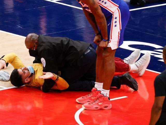 NBA Fan Tackled by Security After Running Onto Court During Wizards-76ers Game