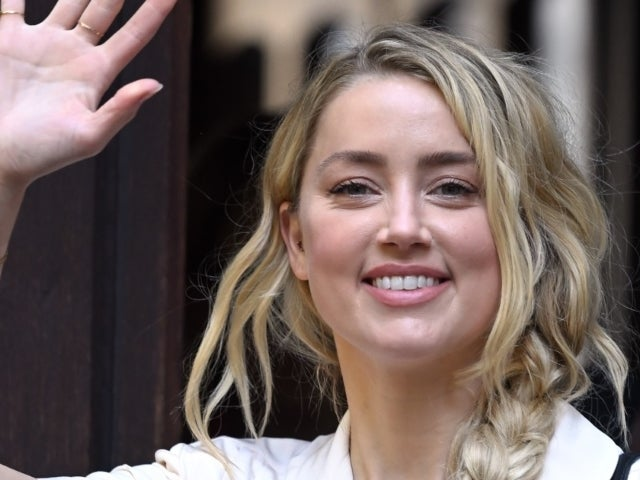 Amber Heard Calls Self Both 'Mom' and 'Dad' Alongside New Photo of Baby Oonagh
