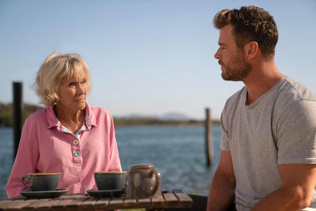 """Valerie Taylor (left) and Chris Hemsworth (right) in National Geographic's """"Shark Beach"""""""
