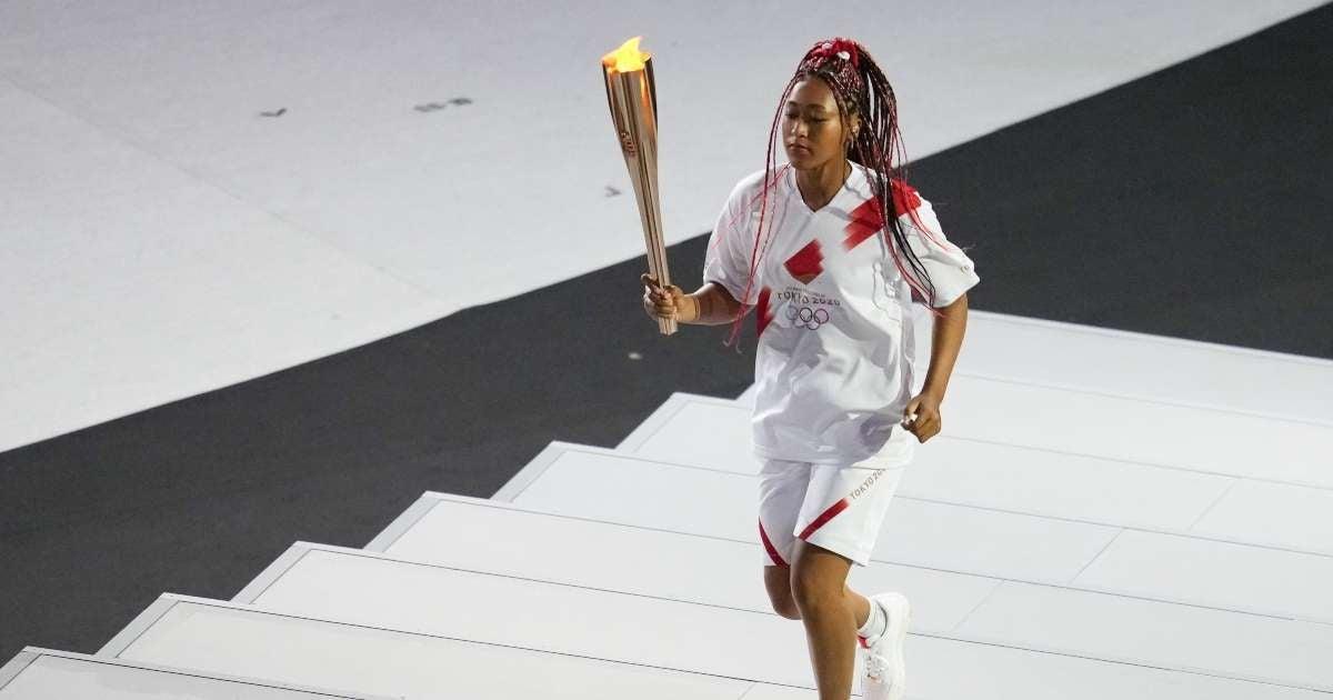 Tokyo Olympics 2021 Naomi Osaka lights cauldron opening ceremony