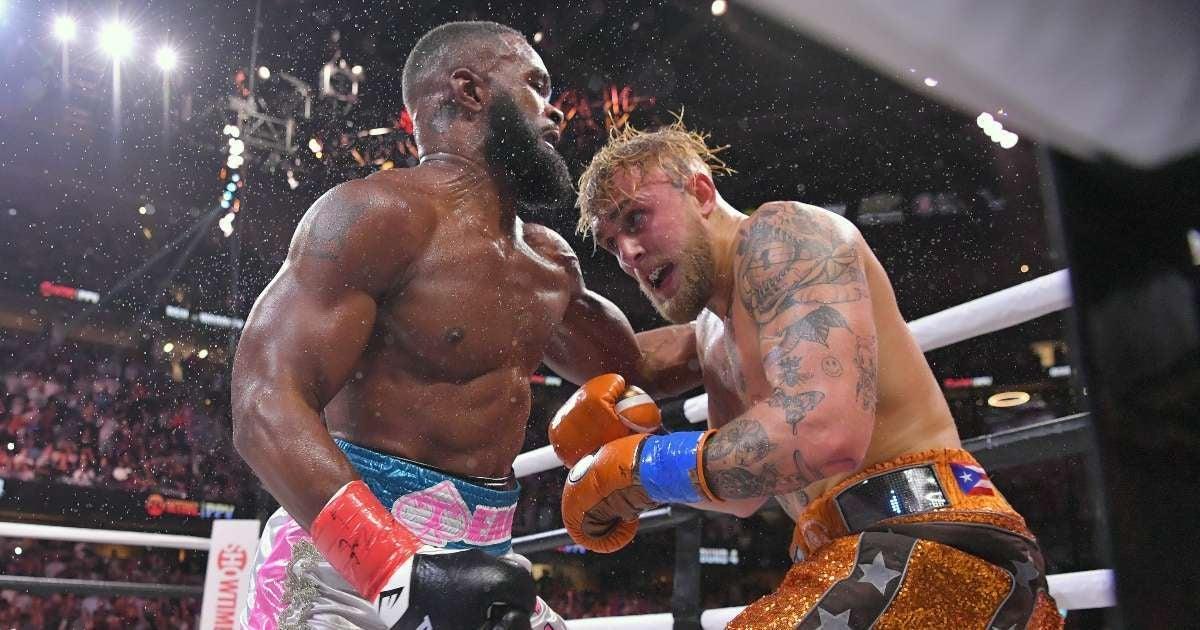 Jake Paul vs Tyron Woodley fans brawl durign boxing match