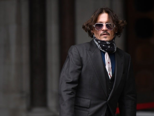 Johnny Depp's New Movie Being 'Buried,' Director Alleges