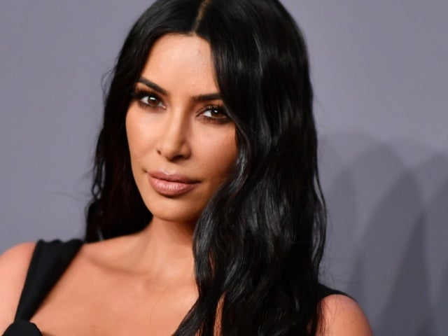 Kim Kardashian Channels 'Pulp Fiction' in Full Body Black Suit at Latest Kanye West Listening Party